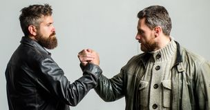 Strong handshake. Friendship of brutal guys. Leadership concept. True friendship of mature friends. Male friendship. Brutal bearded men wear leather jackets stock photo