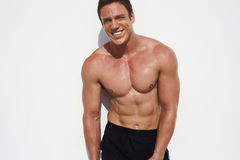 Strong and handsom. Male model posing in half body topless opposit white wall Royalty Free Stock Photos