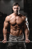 Strong and handsome athletic young man muscles abs and biceps Stock Images