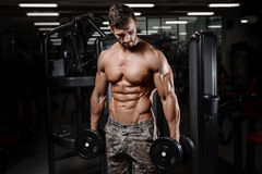 Strong and handsome athletic young man muscles abs and biceps. Strong and handsome athletic young man with muscles abs and biceps. Close-up of a power fitness royalty free stock photo