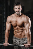 Strong and handsome athletic young man muscles abs and biceps Stock Photos