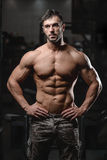 Strong and handsome athletic young man muscles abs and biceps Royalty Free Stock Photography