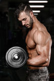 Strong and handsome athletic young man muscles abs and biceps Stock Photo
