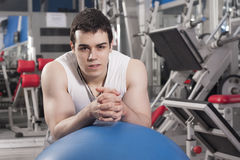 Strong handsome man exercising at the gym Stock Image