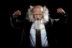 Strong handsome oldman in classic black suit posing Royalty Free Stock Images