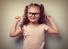 Strong happy successful girl showing muscular. Healthy child lif Stock Photo