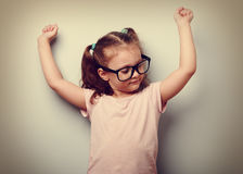 Strong happy successful girl showing muscular. Healthy child lif. Estyle. Vintage portrait royalty free stock photo