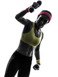 Strong happy woman exercising fitness workout  silhouette Stock Photo
