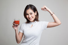 Strong healthy Asian woman with tomato juice. Royalty Free Stock Images