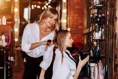 Beautiful woman in hair salon royalty free stock image