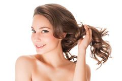 Strong healthy hair. Portrait of a brunette beauty with strong healthy hair stock images