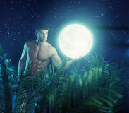 Strong hero carrying the bright moon Stock Image
