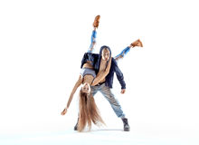 Strong hip-hop guy carrying his dance partner. Strong hip-hop boy carrying his dance partner royalty free stock photos