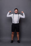 Strong hipster man in studio Royalty Free Stock Images