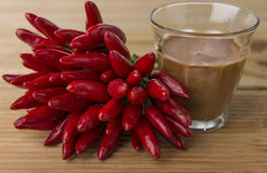 Strong (hot) cafe. Hot cafe with chili paprika Royalty Free Stock Images