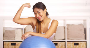 Strong Japanese woman showing off muscles Stock Images