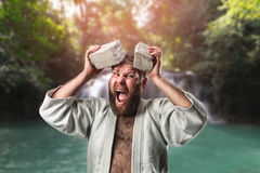 Strong karateka breaks a brick Royalty Free Stock Photos