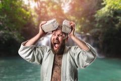 Strong karateka breaks a brick Royalty Free Stock Photos