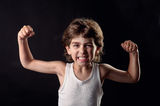 Strong Kid showing his muscles Royalty Free Stock Photo