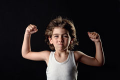 Strong Kid showing his muscles Royalty Free Stock Images