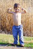 Strong kid showing the muscles Stock Photo