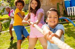 Free Strong Kids Pull Rope In The Competitive Game Stock Photo - 161011800
