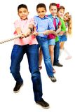 Strong kids pulling rope royalty free stock photos