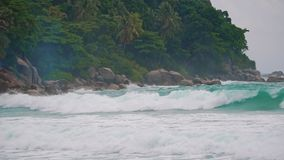 Strong large sea waves before a storm on a tropical island.  stock footage