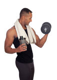 Strong Latin American man with dumbbells drinking protein Stock Photography