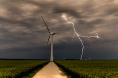 Strong lightning threatening wind turbines Royalty Free Stock Photos