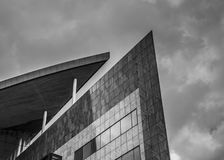 Strong lines and shapes of a high rise building, rendered in black and white to accentuate the shapes. Of the building Stock Image