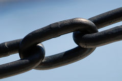 Strong Link. Of a heavy metal chain on out of focus sea water background Royalty Free Stock Photos