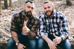 Strong lumberjack chopping wood Royalty Free Stock Photography