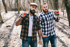 Strong lumberjack chopping wood Stock Photography