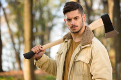 Strong lumberjack man holding axe Stock Image