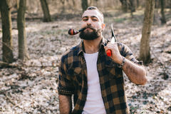 Strong lumberjack working in the forest Stock Photo