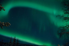Strong majestic aurora borealis, northern light on sky Stock Images