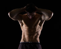 Strong male athlete posing on black Royalty Free Stock Photo