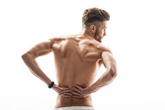 Strong male athlete suffers from pain Stock Photography