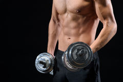 Strong male athlete training with dumbbells Royalty Free Stock Image