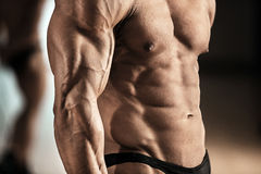 Strong male bodybuilder. Close-up of muscular man with strong biceps stock images