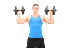 Strong male bodybuilder exercising with barbells Stock Image