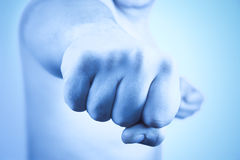 Strong male fist Stock Images