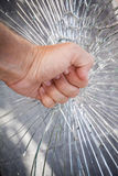 Strong male fist with broken glass Stock Photo