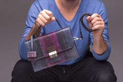 Strong male hands holding handbag Stock Images