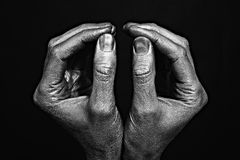 Strong male hands in silver paint Royalty Free Stock Image