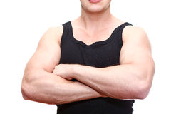 Strong male torso. One handsome Caucasian musculan man torso in black t-shirt with clasped hands on breast isolated on white background Royalty Free Stock Photography