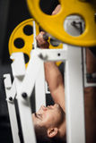Strong male weightlifter lifting a barbell Stock Photos