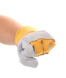 Strong male worker hand glove clenching fist. Royalty Free Stock Images