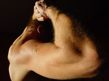 Strong man. Male with hand on head part of his back Stock Photography